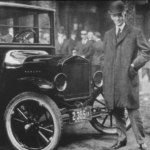 Henry Ford, Founder of Ford Motor Company, standing next to a Ford Car. Ulmer's Auto Care provides the best Ford repair service in Milford, Anderson Township and Cincinnati, OH.