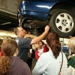 Mechanic showing auto repair on car - Anderson & Milford OH