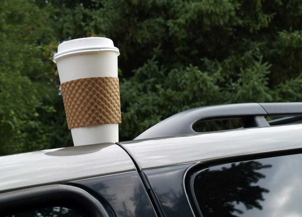 Coffee cup left on the top of a car