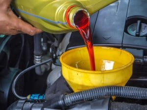 why is transmission fluid leaking beneath the vehicle?